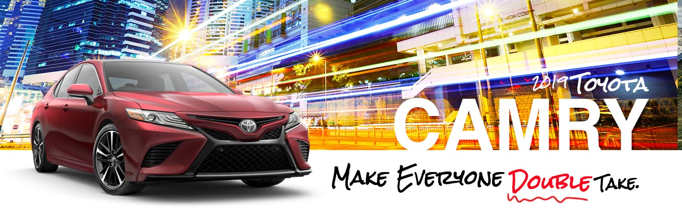 2019 Red Exterior Camry On Road at Carlock Toyota of Tupelo