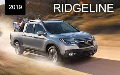silver 2019 honda ridgeline dirt road