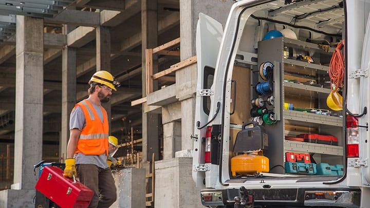 Construction worker walking toward rear of NV Cargo