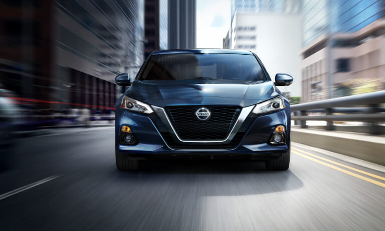 2019 Nissan Altima driving head on in city