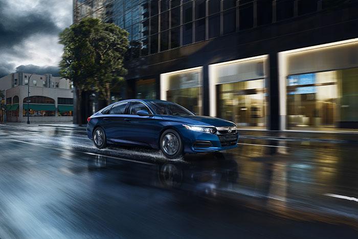 Blue 2019 Honda Accord driving in rain
