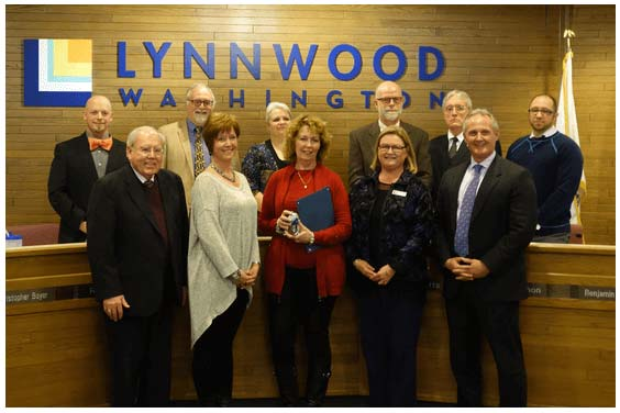 Acura of Lynnwood Accepting the 29th annual Business Award from the City of Lynnwood