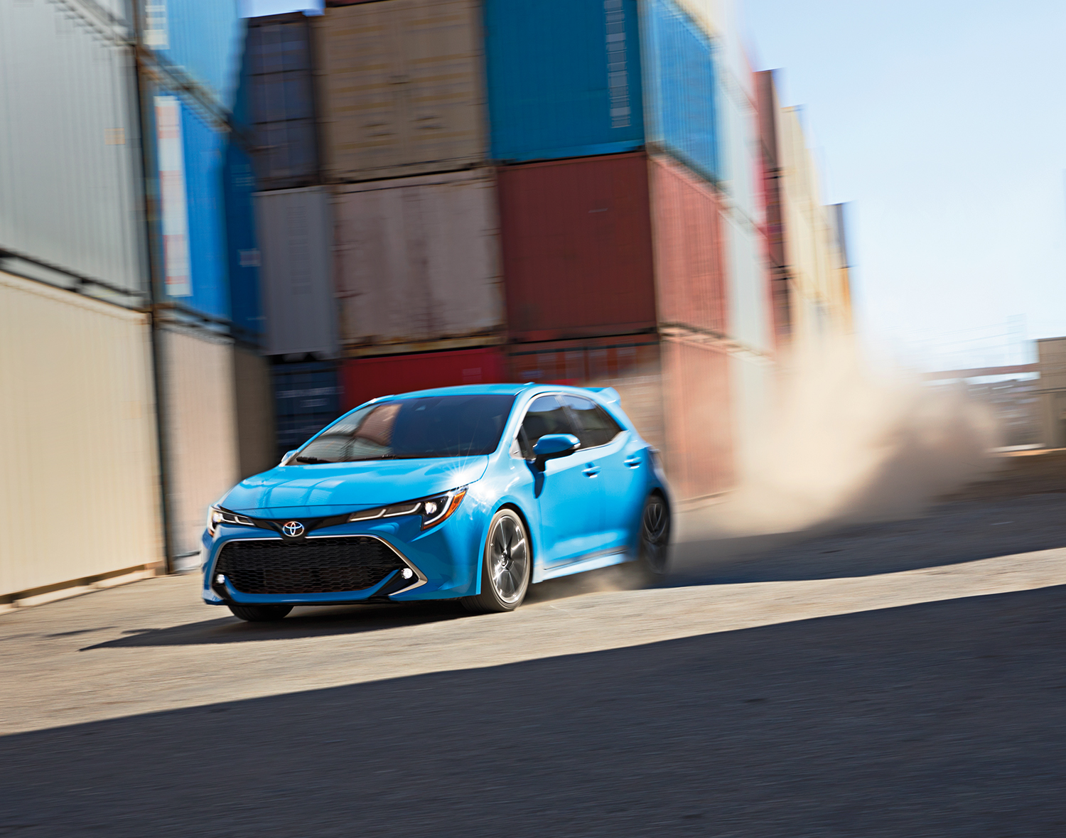 blue 2019 Corolla Hatchback kicking up dust in a storage area