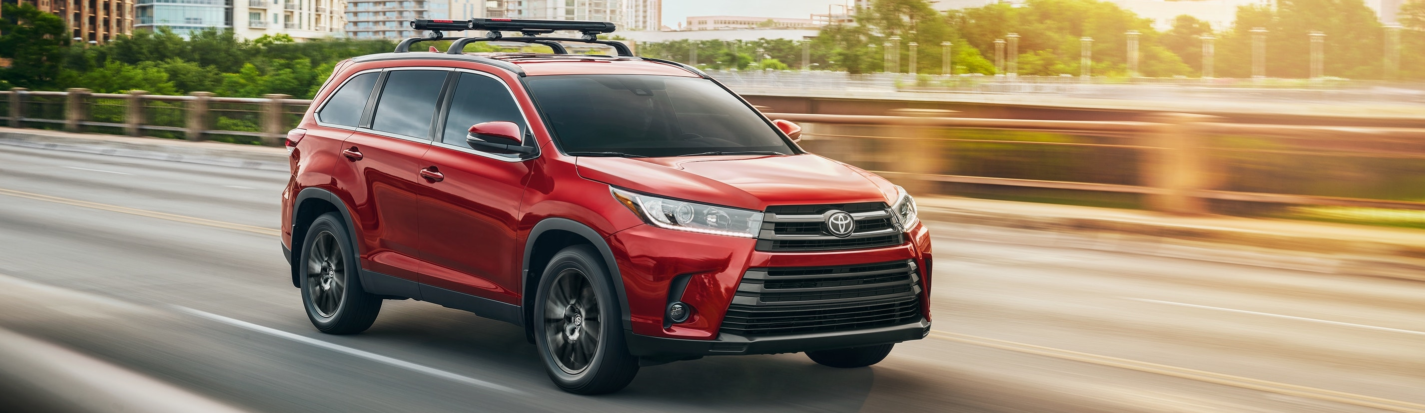 2019 Red Exterior Highlander On Road at Toyota of El Cajon