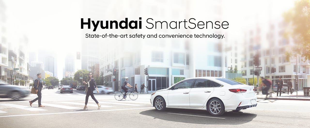 Hyundai on a busy pedestrian street heading description Hyundai SmartSense