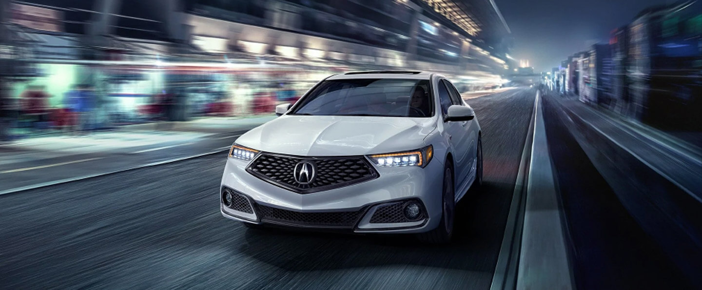 Three 2020 Acura TLX sedans racing across a modern bridge