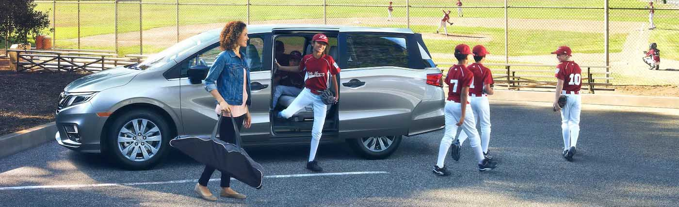 Honda Odyssey with mom and baseball kids
