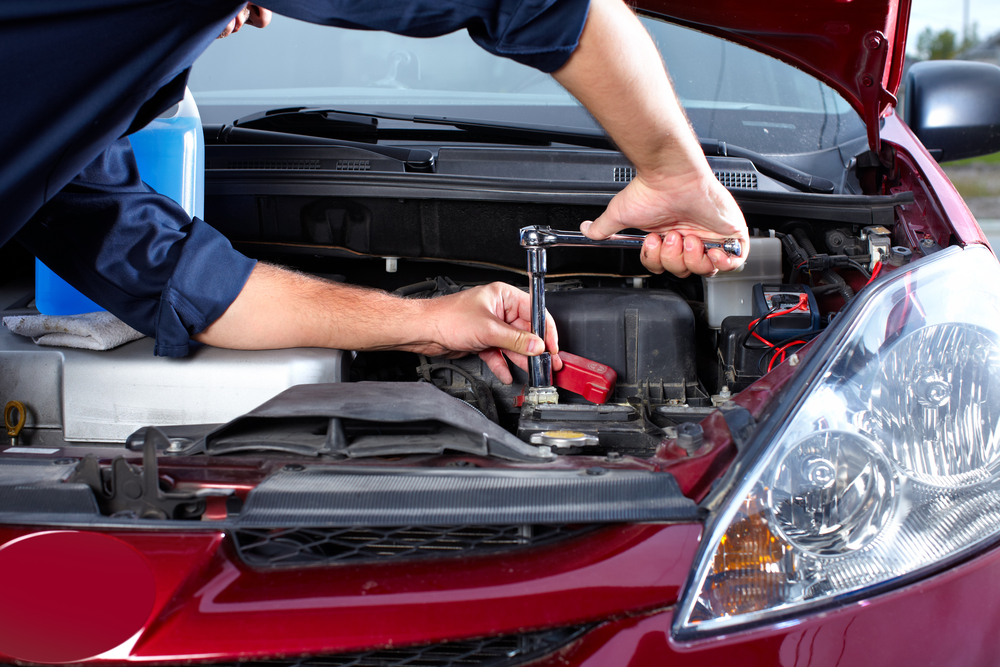 Certified Professionals Fixing Vehicle