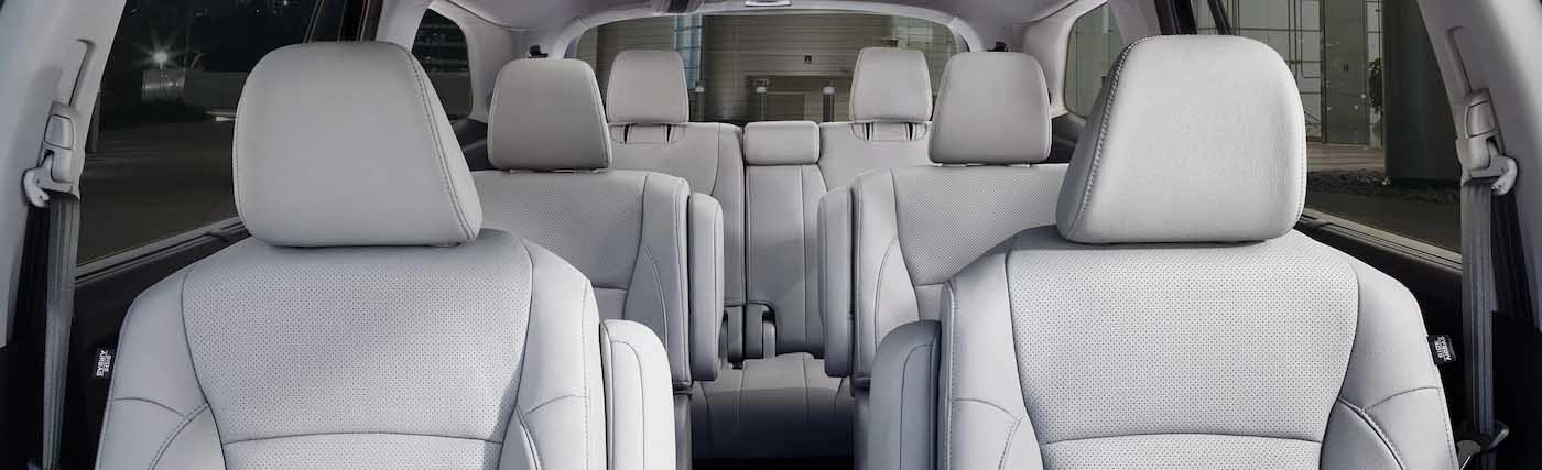 Safety features and interior of the 2020 Honda Pilot - available at our Honda dealership near Fort Myers, FL.