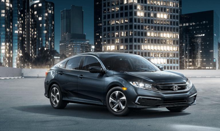 A black 2019 Honda Civic at night