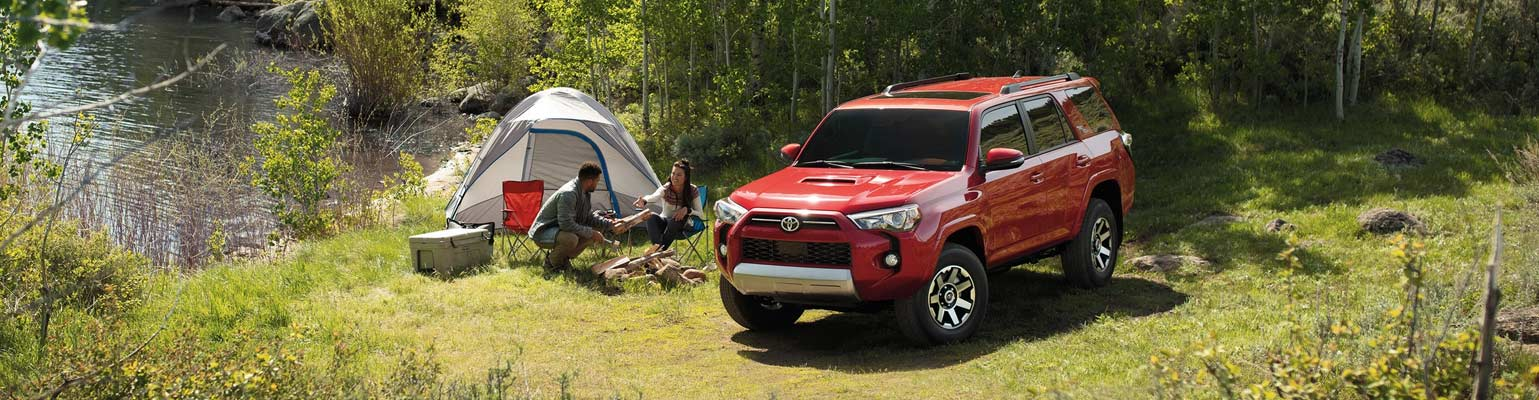 Image of the 2020 Toyota 4Runner with people camping next to a lake