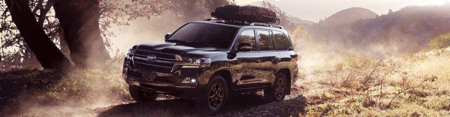 Image of the 2020 Toyota Land Cruiser driving through rough terrane