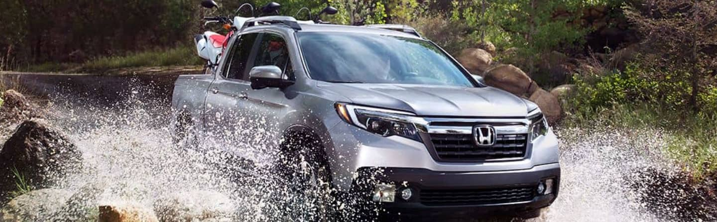 2019 Honda Ridgeline Driving Through a Puddle