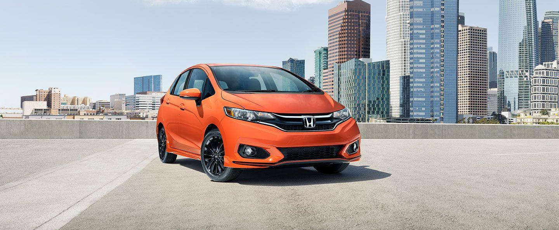 orange 2019 Honda Fit on parking garage roof