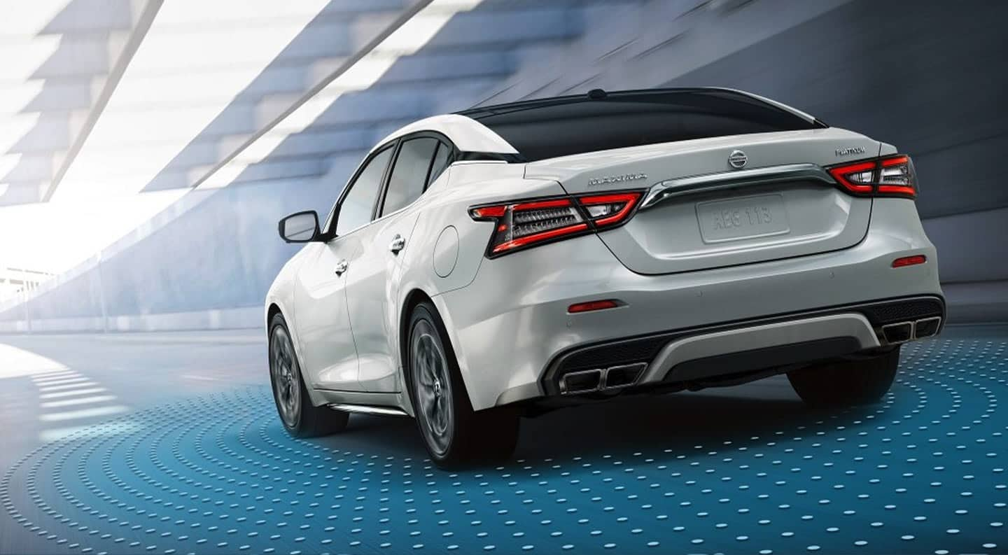 The 2020 Nissan Maxima in white driving