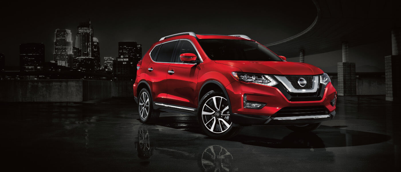 2019 Nissan Rogue driving in city at night
