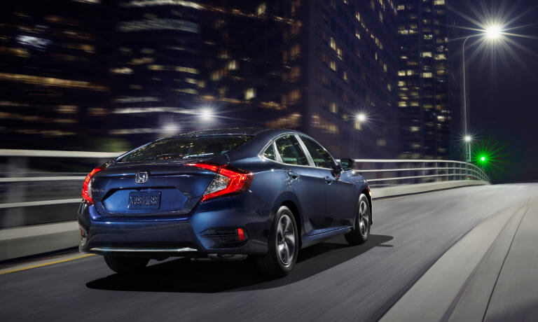 A blue 2020 Honda Civic at night