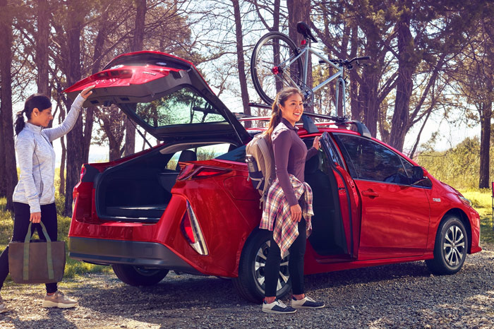 Open trunk of red Toyota Prius Prime