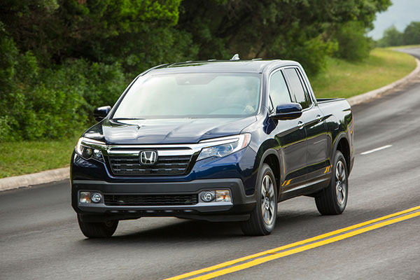 Blue 2020 Honda Ridgeline on the road