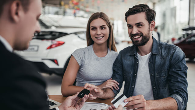 Young couple applying for auto loan