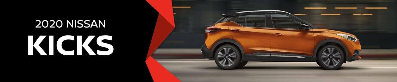 Orange Nissan Kicks Driving
