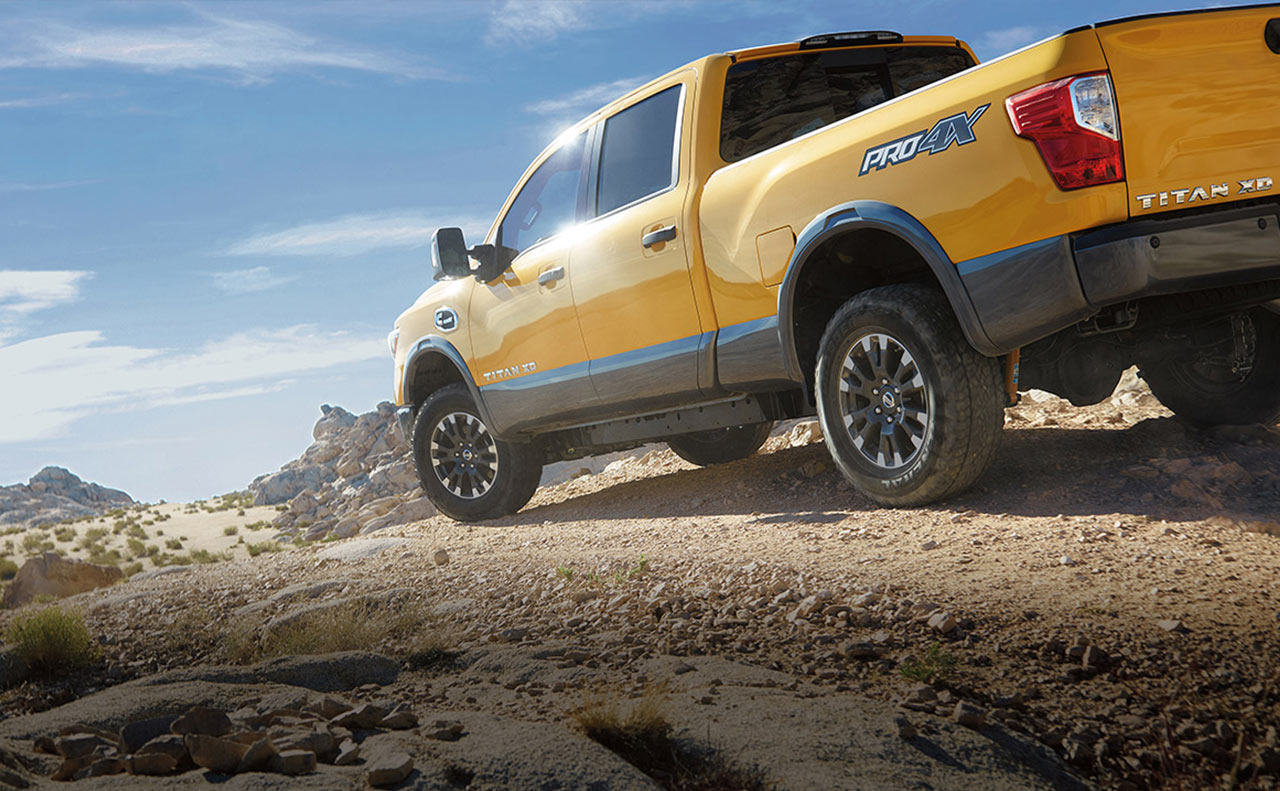 2016 nissan titan exterior yellow xd pro4x rims wheel dirt