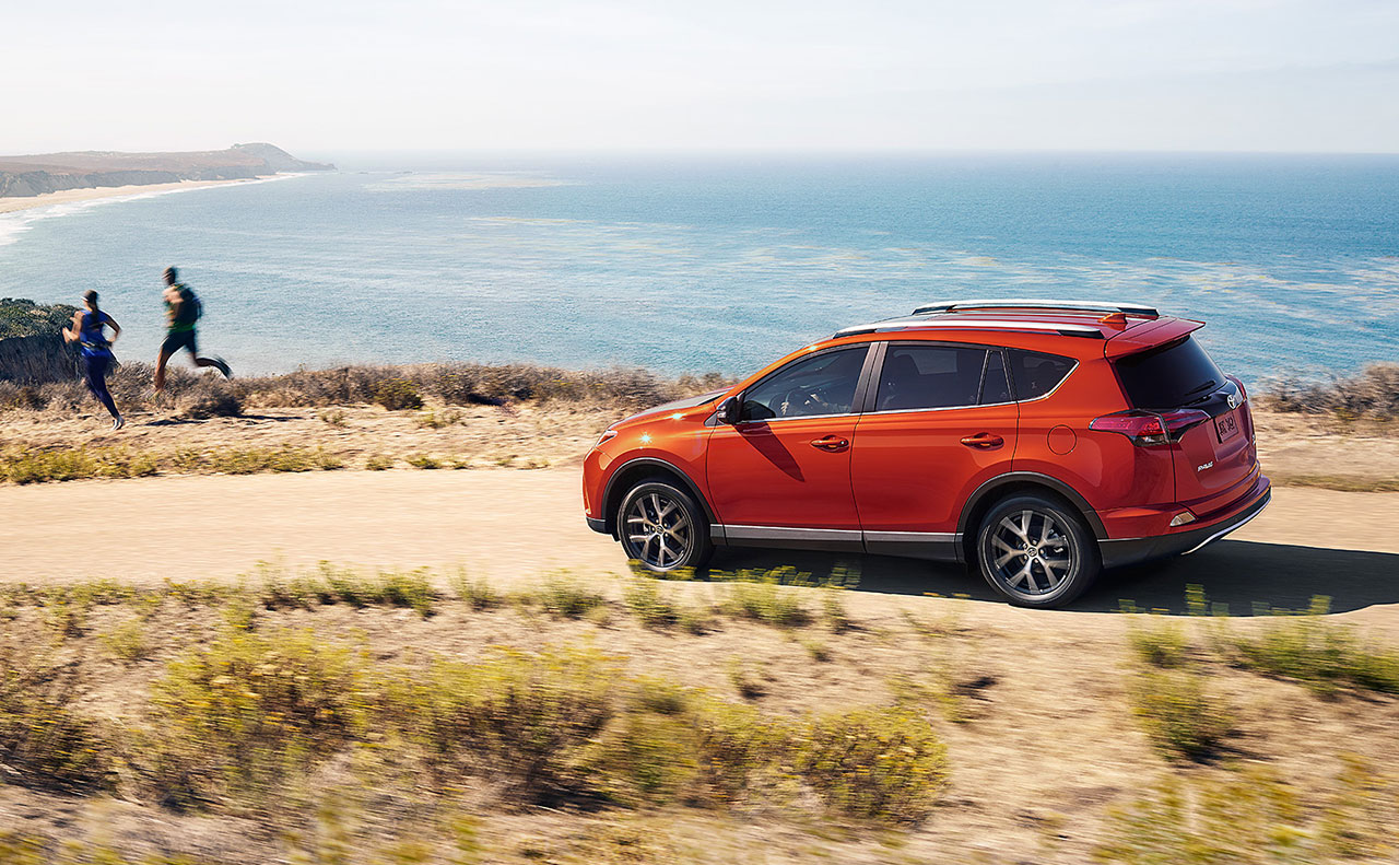2016 toyota rav4 exterior orange in motion