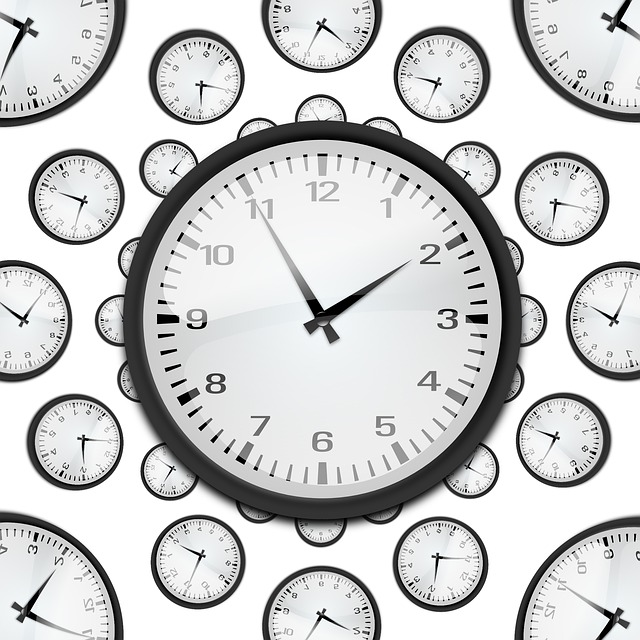 Picture of a clock face surrounded by smaller clock faces