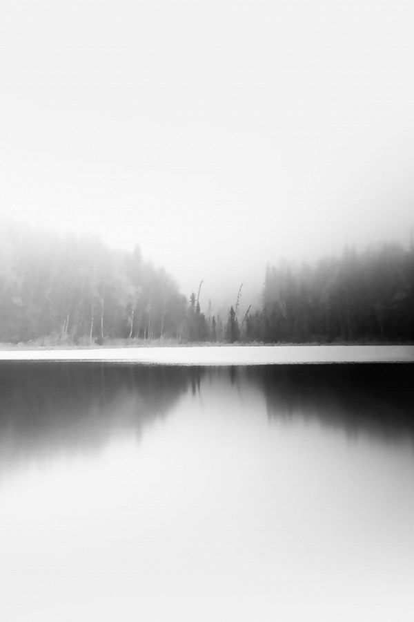 The lake with snow fog