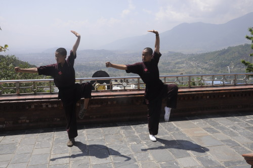 "KALABARI VILLAGE, NEPAL - MAY 2, 2015 - Jigme Wangchuk, 17 (on the left), and Jigme Konchok, 21 (on the right) are two of the ""kung fu nuns of Kathmandu"", from the Druk Amitabha Mountain nunnery, which is a unique example of gender reversal in a rarefied world of monasteries . The kung fu nuns are using their energy for providing relief to those devastated by the deadly earthquake that hit Nepal a week ago. In this picture, the two nuns are striking a kung fu pose from their practice session. (Pradeep Bashyal for The Washington Post)"