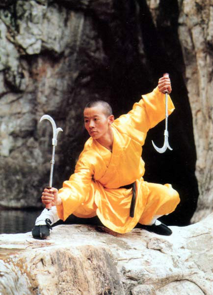 Chicken Sickle - The chicken sickle is a bladed weapon that can be anywhere from 1½ to 3 feet long. The defining feature is the claw at the end, which looks a little bit like a chicken's foot. The chicken sickle is the signature weapon of the Xing Yi Quan style. (source: americanshaolinkungfu.org)