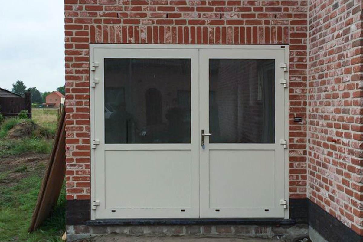 openslaand-garagedeur-vlakke-plaat-Hamme-belgie