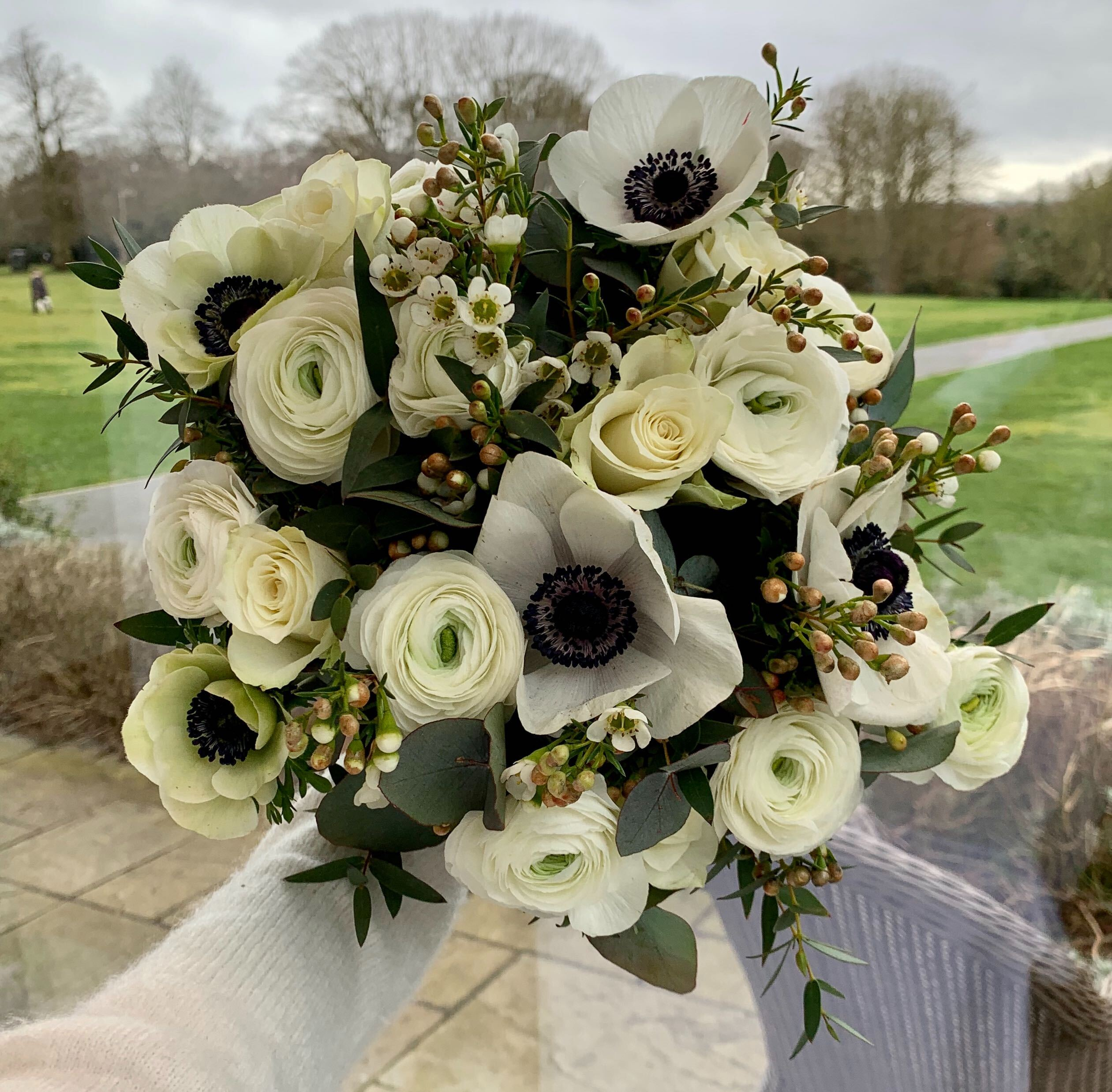 Winter bridal bouquet with ranunculus and anemones