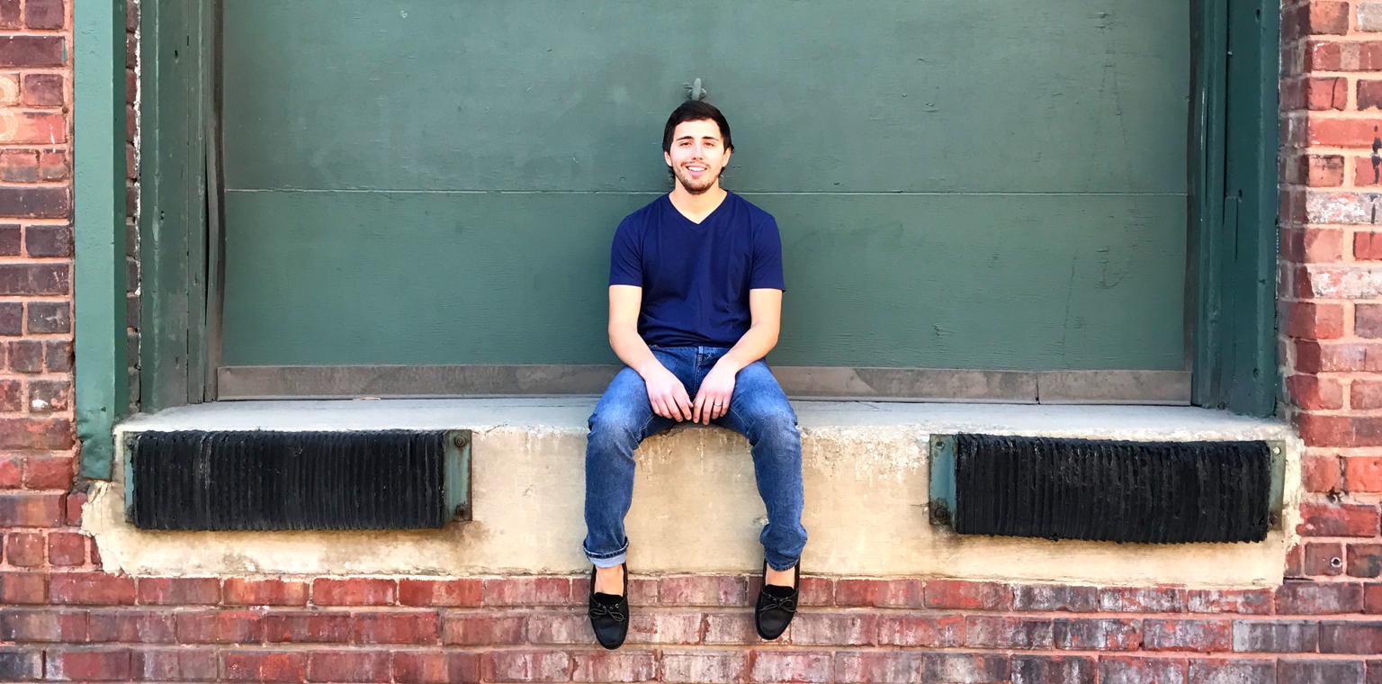 Gary Bunofsky sitting on a loading dock.
