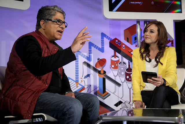 Video blogger Shira Lazar interviewing new age spiritual guru Deepak Chopra in the Whats Trending section