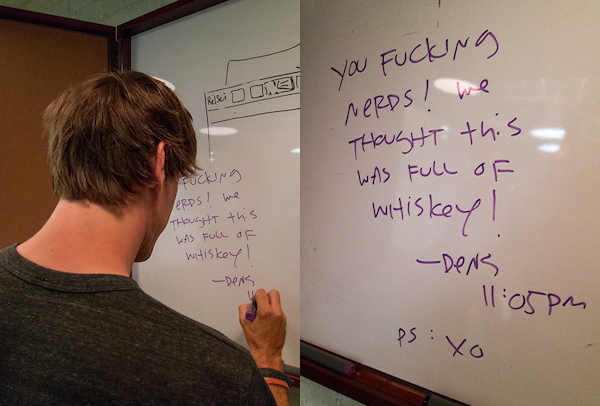 foursquare CEO Dennis Crowley on realizing the whisky cabinet was really just a hidden whiteboard (Photo: Scott Beale / Laughing Squid)