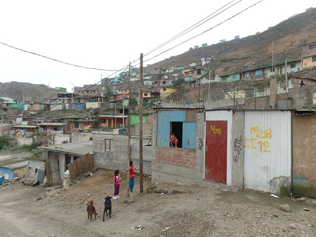 Ralph and his wife visit a local village in Lima, Peru