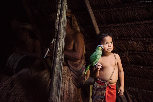 Yagua tribe child with parrot