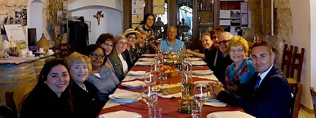 Group enjoying dinner at a winery in Matera, Italy