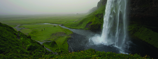 Seljalandsfoss waterfall with lots of dust particles in the air