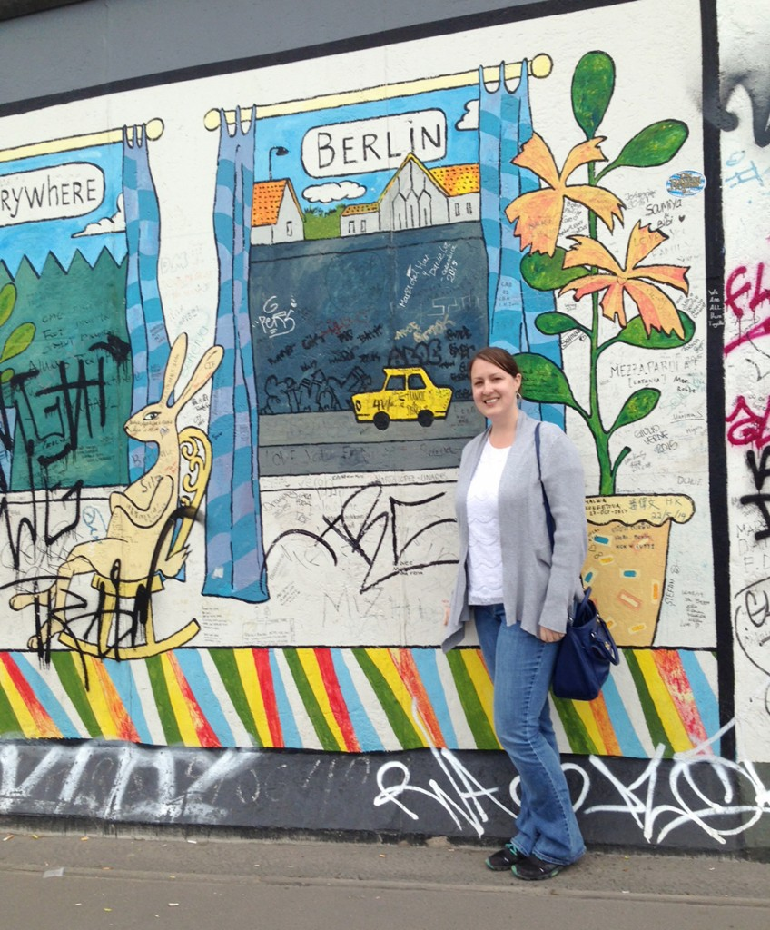 Sarah in front of the Berlin Wall in Germany