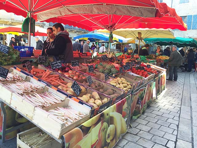 Perusing an outdoor market | Go Ahead Tours travel blog
