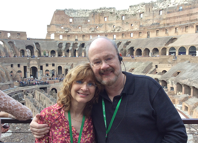 Pauline and Walter in front of the Colosseum on tour in Rome, Italy