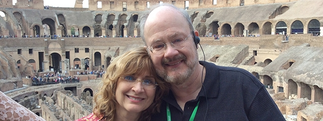 Pauline and Walter in front of the Colosseum in Rome, Italy