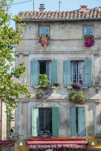 Colorful window boxes decorate the homes in Arles