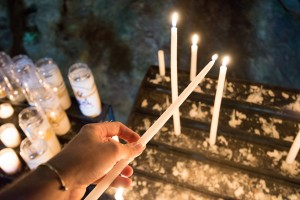 Lighting a candle at the shrine of Mary Magdalene