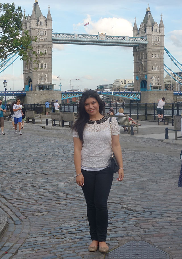 Vivian in front of the Tower Bridge in London, England