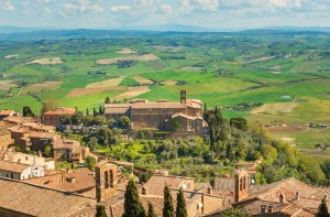 A patchwork of vineyards and farms surrounds Montalcino