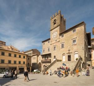 The 13th-century clock tower in Cortona's Piazza della Repubblica