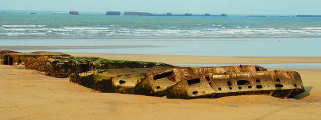 Remains of Mulberry Harbor on the beach and in the sea,Arromanch, Normandy France